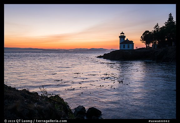 Lime Kiln Lighthouse at sunset, Lime Point State Park, San Juan Island. Washington (color)