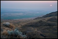 Sun rising in haze over Saddle Mountain, Hanford Reach National Monument. Washington ( color)