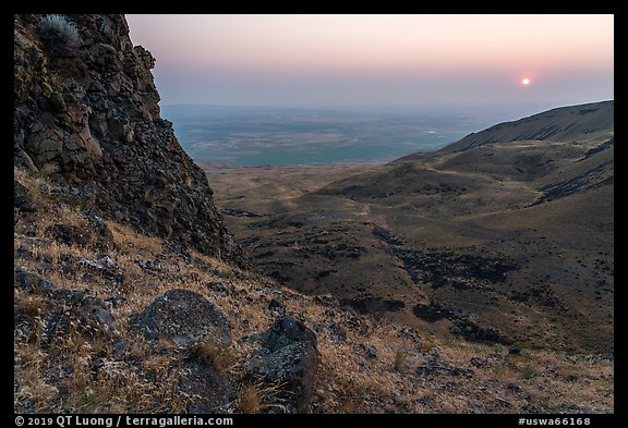 Volcanic outcrop and rising sun, Saddle Mountain, Hanford Reach National Monument. Washington (color)