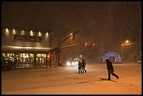 People cross street in night blizzard. Jackson, Wyoming, USA ( color)
