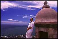 Man leaning against a lookout turret, Fort San Felipe del Morro. San Juan, Puerto Rico