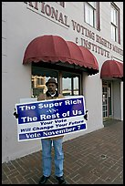 African-American man holding a voting sign in front of the voting rights museum. Selma, Alabama, USA
