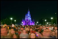 Crowds on Main Street with castle in the back at night. Orlando, Florida, USA ( color)