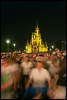 Crowds walking away from Cinderella Castle at night. Orlando, Florida, USA ( color)