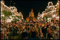 Main Street at night with crowds and castle. Orlando, Florida, USA ( color)
