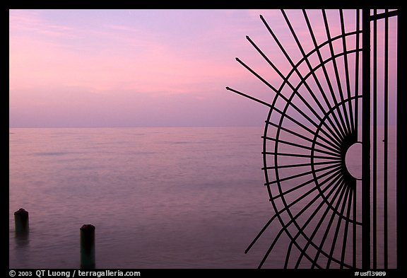 Grid and pilings and sunrise. Key West, Florida, USA