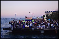 Crowds watching sunset at Mallory Square. Key West, Florida, USA (color)