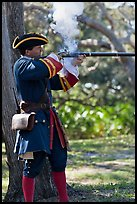 Man in period costume fires smooth bore musket, Fort Matanzas National Monument. St Augustine, Florida, USA ( color)