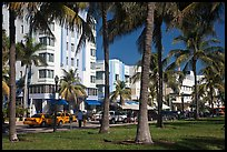 South Beach Art Deco buildings seen through palm trees, Miami Beach. Florida, USA (color)