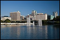 Fountains and morning skyline from Lake Lucerne. Orlando, Florida, USA ( color)
