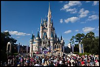 Iconic Cindarella Castle with tourists gathered for show, Magic Kingdom. Orlando, Florida, USA ( color)