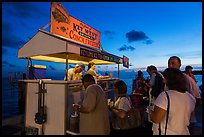 People buying food at stand on Mallory Square. Key West, Florida, USA (color)