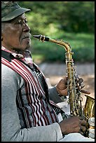 African-American musician with saxophone in square. Savannah, Georgia, USA ( color)