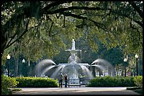 Fountain in Forsyth Park with couple standing. Savannah, Georgia, USA ( color)