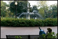 Woman reading in front of Forsyth Park Fountain. Savannah, Georgia, USA ( color)