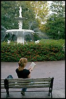 Woman reading a book in front of Forsyth Park Fountain. Savannah, Georgia, USA ( color)