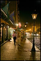 People on sidewalk of River Street by night. Savannah, Georgia, USA ( color)
