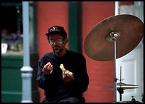 Street musician taking a lunch break, French Quarter. New Orleans, Louisiana, USA ( color)