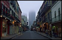Bourbon street and the new town in the fog, French Quarter. New Orleans, Louisiana, USA ( color)
