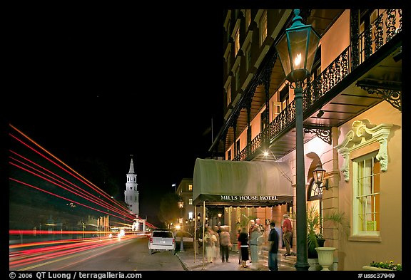 Street, church, and Mills house hotel with many guests at night. Charleston, South Carolina, USA
