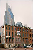 Row of brick buildings and Bell South Tower in fog. Nashville, Tennessee, USA ( color)