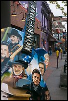 Guitar-shaped sign with images of famous singers on Broadway sidewalk. Nashville, Tennessee, USA (color)
