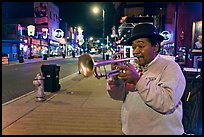 Jazz Street Musician on Beale Street by night. Memphis, Tennessee, USA (color)