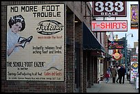 Old advertising on brick building and sidewalk, Beale street. Memphis, Tennessee, USA (color)