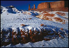 Snow on the floor, with Three Sisters in the background. Monument Valley Tribal Park, Navajo Nation, Arizona and Utah, USA ( color)