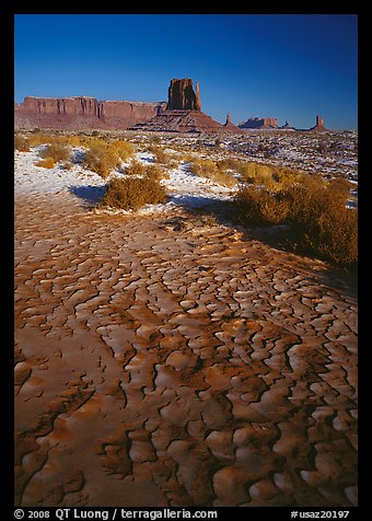 Clay pattern on floor and buttes in winter. Monument Valley Tribal Park, Navajo Nation, Arizona and Utah, USA