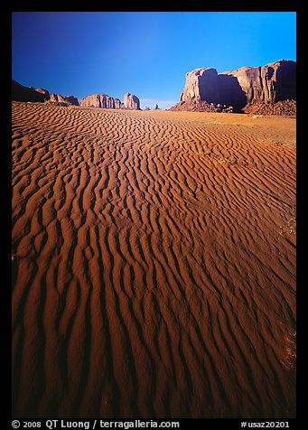Ripples on sand dunes and mesas, late afternoon. Monument Valley Tribal Park, Navajo Nation, Arizona and Utah, USA
