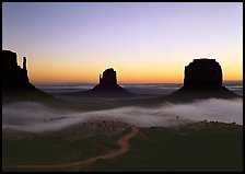 Mittens and fog, sunrise. Monument Valley Tribal Park, Navajo Nation, Arizona and Utah, USA