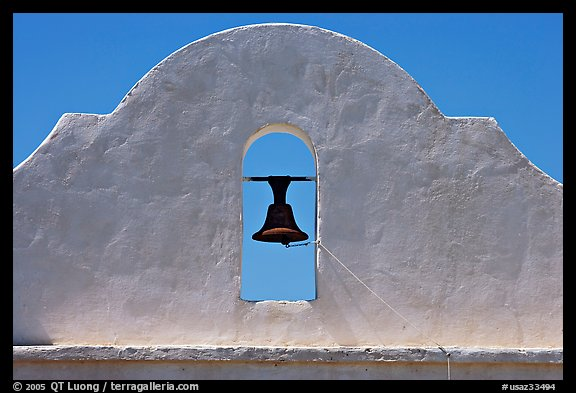 Bell and whitewashed wall, San Xavier del Bac Mission. Tucson, Arizona, USA