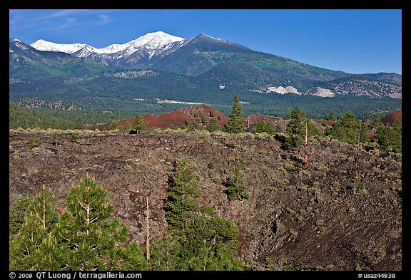 Lava fields and snow-capped San Francisco Peaks, Sunset Crater Volcano National Monument. Arizona, USA (color)