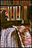 Stacks of varicolored blankets and rugs weaved by Navajo Indians. Hubbell Trading Post National Historical Site, Arizona, USA ( color)
