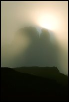 Butte in fog. Monument Valley Tribal Park, Navajo Nation, Arizona and Utah, USA ( color)