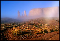 Three sisters, clearing fog, morning. Monument Valley Tribal Park, Navajo Nation, Arizona and Utah, USA ( color)