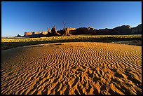 Sand dunes, Yei bi Chei, and Totem Pole, late afternoon. Monument Valley Tribal Park, Navajo Nation, Arizona and Utah, USA
