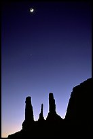 Three sisters and moon, dusk. Monument Valley Tribal Park, Navajo Nation, Arizona and Utah, USA