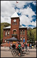 Mountain bikers in front of San Miguel County court house. Telluride, Colorado, USA