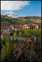 Mountain Village with newly leafed spring trees and snowy peaks. Telluride, Colorado, USA