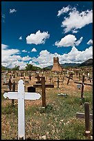 Wooden crosses and old adobe church. Taos, New Mexico, USA
