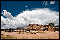 Afternoon cloud hovering over multi-family houses built by Pueblo Indians. Taos, New Mexico, USA