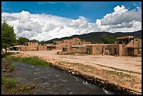 Rio Pueblo stream and pueblo village. Taos, New Mexico, USA (color)