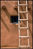 Ladder, Vigas, and blue window. Taos, New Mexico, USA