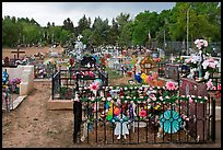 Graves with colorfull flowers. Taos, New Mexico, USA
