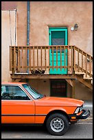 Car and adobe house detail. Taos, New Mexico, USA