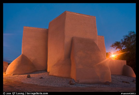 San Francisco de Asisis mission buttresses at night, Rancho de Taos. Taos, New Mexico, USA