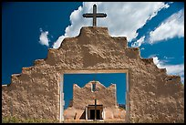 Adobe church framed by entrance in earthen wall, Picuris Pueblo. New Mexico, USA (color)