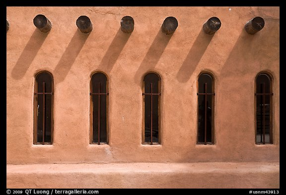 Facade with vigas (heavy timbers) extending through walls to support roof, Chimayo sanctuary. New Mexico, USA